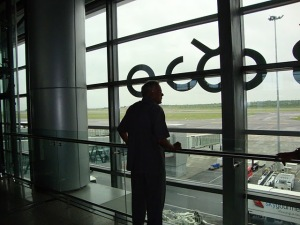 My Dad Enjoying the View  of 'Flights'at GMR Airport